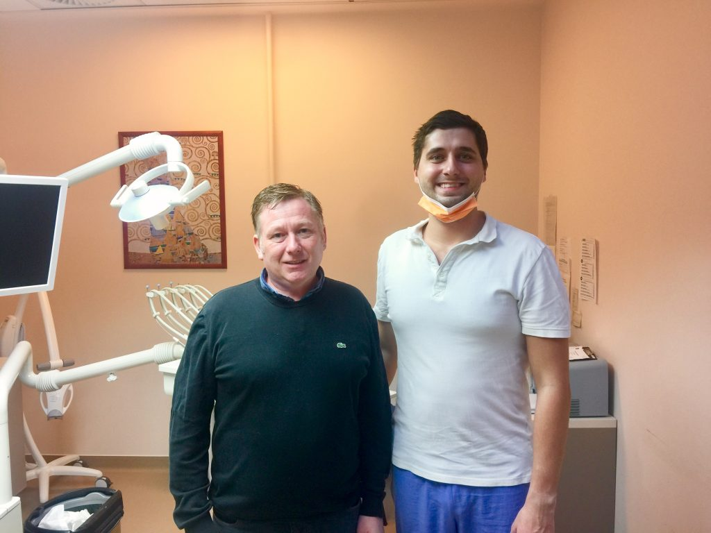Jason and his oral surgeon after his treatment az MDental Clinic